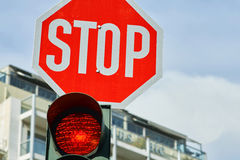Red traffic light and a stop sign. Red traffic light and a stop  sign Stock Photos