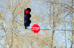 Red Traffic Light With Stop Sign. Next To It Concept Royalty Free Stock Photo