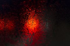 Red traffic lights in rain at night. Some red traffic lights in rain at night Stock Photos