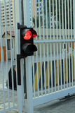 Red traffic lights with security barrier and security gates Stock Photography