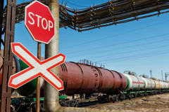 Red traffic STOP sign in front of the train moving in the backgr Stock Photography
