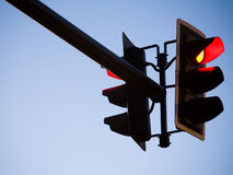 Red Traffice Light. A red overhead traffic light with blue sky Stock Photos