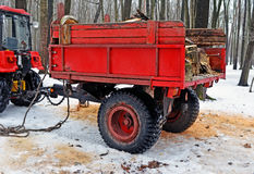 The red trailer with firewood 1 Stock Photo