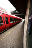 Red train. In the station royalty free stock photography