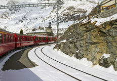 Red train at  Alp Grüm station Stock Photos