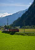 Red train in alps Royalty Free Stock Image