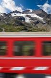 Red Train and Bernina Alps - Switzerland Royalty Free Stock Photo