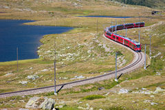 Red train of Bernina. St Moritz, Switzerland - August 14, 2013: From Tirano part of the red train of Bernina leading in Switzerland, St. Moritz. Are about 60 km Royalty Free Stock Images