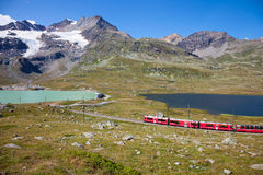 Red train of Bernina. St Moritz, Switzerland - August 14, 2013: From Tirano part of the red train of Bernina leading in Switzerland, St. Moritz. Are about 60 km Royalty Free Stock Photo