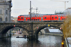 Red train on the bridge Royalty Free Stock Photography