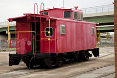 Red train caboose. Beautiful red train caboose with yellow rails royalty free stock photos