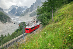 A red train in French Alps Stock Photography