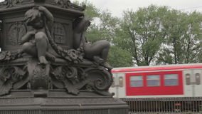 Red train in Hamburg. Red train on the bridge passes by in Hamburg, Germany. Column detail. Shot on Canon 5D Mark II with Prime L Lenses stock footage