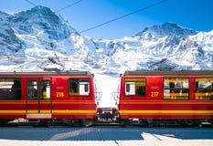 Red train of Jungfrau Bahn at Kleine Scheidegg station Stock Photos