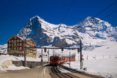 Red train of Jungfrau Bahn at Kleine Scheidegg station. The main transportation to Jungfraujoch stock photography