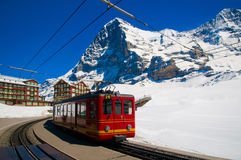 Red train of Jungfrau Bahn at Kleine Scheidegg station. The main transportation to Jungfraujoch royalty free stock photo