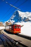 Red train of Jungfrau Bahn at Kleine Scheidegg station Stock Image