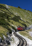 Red train in the mountains Royalty Free Stock Images