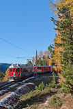 Red train and mountains royalty free stock photos