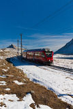 Red train and mountains Royalty Free Stock Photography