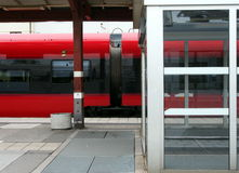 Red train at the platform. Detail of a red train at a railway station Stock Photography