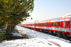 Red train on platform in winter. Red train on platform with trees in winter Royalty Free Stock Photo