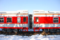 The red train on platform in winter. The red train on platform with snow in winter Stock Photography