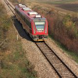 Red train on the rails Royalty Free Stock Image
