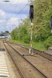 Red train signal. Between railway tracks Royalty Free Stock Image