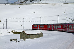 Red train and snow valley Stock Photos