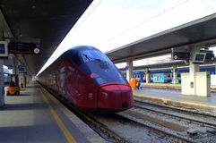 Red train at Venice railway station Royalty Free Stock Images
