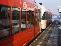 Red train waiting at a Dutch railway station Royalty Free Stock Photography