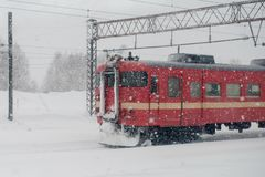The red train was driving in the snow stock photos