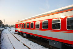 The red train  in winter. With blue sky Royalty Free Stock Images