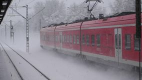 Red train in winter going in slow motion. Red train going in slow motion in winter with snow stock video footage