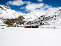 Red train in winter landscape near St. Moritz in the Swiss Alps Stock Images
