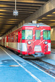 Red train at the Zermatt train station Royalty Free Stock Image