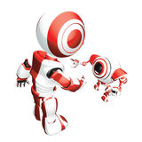 Red Trainer Robot. A conceptual image of a red colored parent robot training a baby robot, on a white background Royalty Free Stock Photo