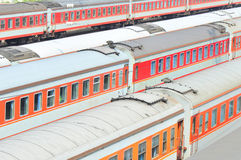 Red trains. Trains at railway station closeup royalty free stock image