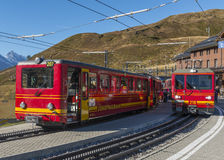 Red Trains of Jungfraubahn Royalty Free Stock Photography