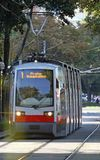 Red tram carries passengers for European cities Royalty Free Stock Photography