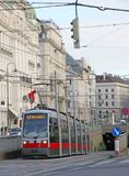 Red tram carries passengers for European cities Stock Image