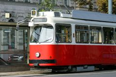 Red tram carries passengers for European cities Royalty Free Stock Photo