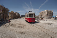 Red tram and cobble streets under construction Stock Image