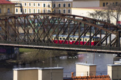 A red tram crossing a steel bridge in Prague Stock Photos