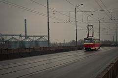 Red tram goes across the bridge Royalty Free Stock Image