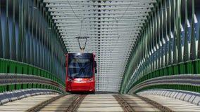 Red tram green bridge royalty free stock photography