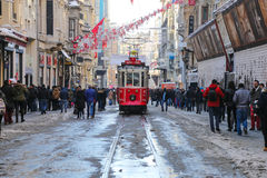 Red Tram on Istiklal Avenue. ISTANBUL, TURKEY - JANUARY 01, 2016: Historic red tram carrying people on Istiklal Avenue. Red tram is one of the symbol of Istanbul Royalty Free Stock Photography