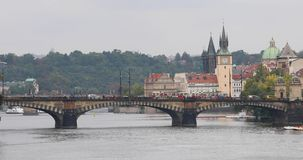 Red tram on Legion Bridge in Prague stock video footage