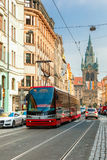 Red tram near Jindrisska Tower in Prague, Czech Royalty Free Stock Images